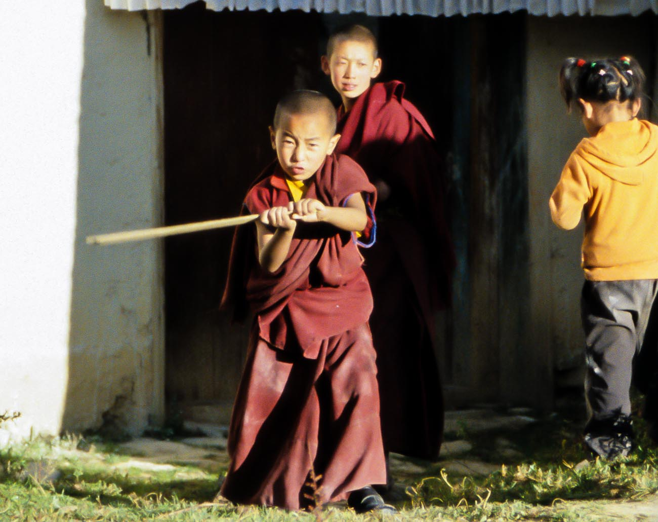 Two boy monks playing In Zhongdian's Songzanlin Monastery near the border of Tibet and China ©2013 Nick Katin