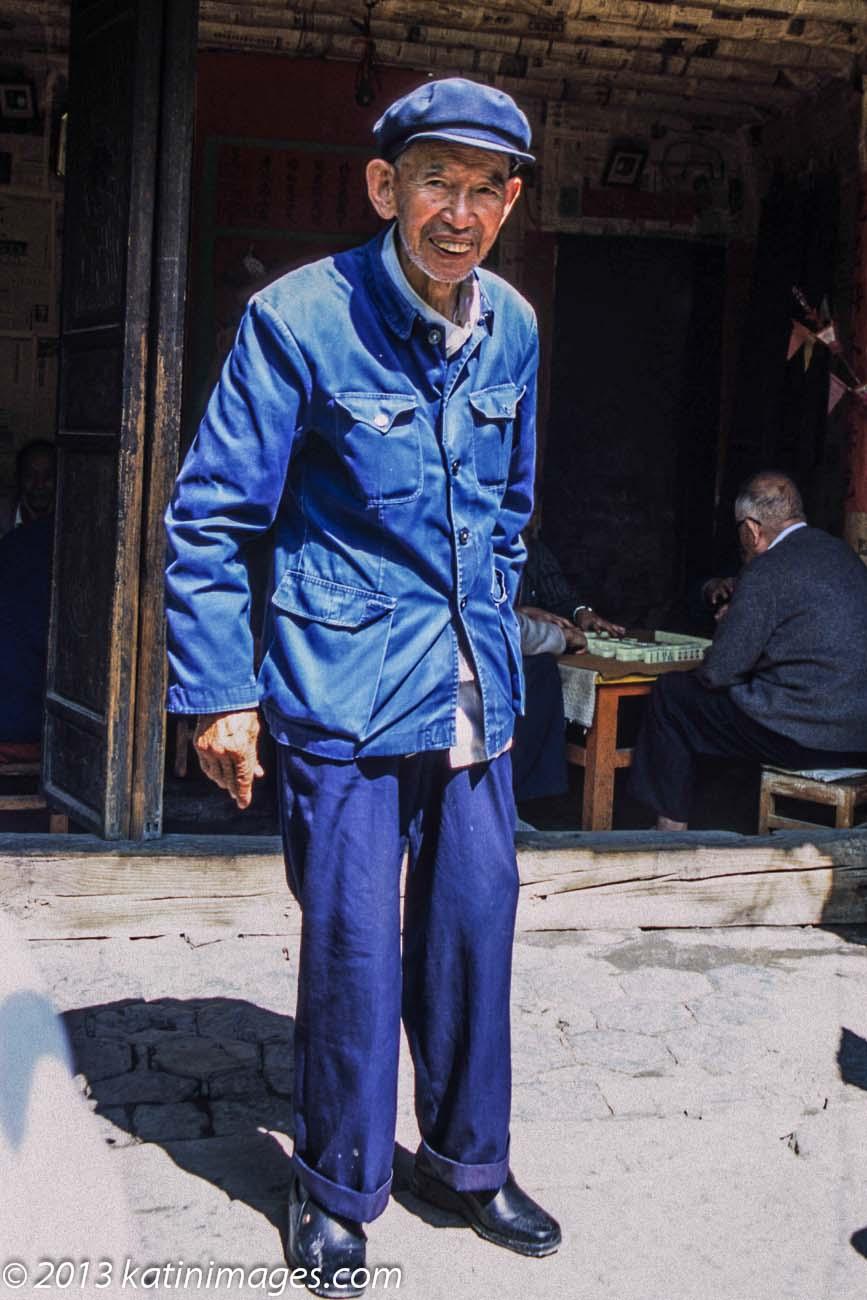 Man in a  Zhongshan or Mao  suit posing in the village Xizhou near Dali in the Yunnan province of China