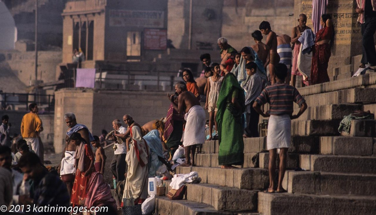 Pilgrims on the Ghats. People on the Ghats or steps on the banks of the river Ganges in Varanasi, India