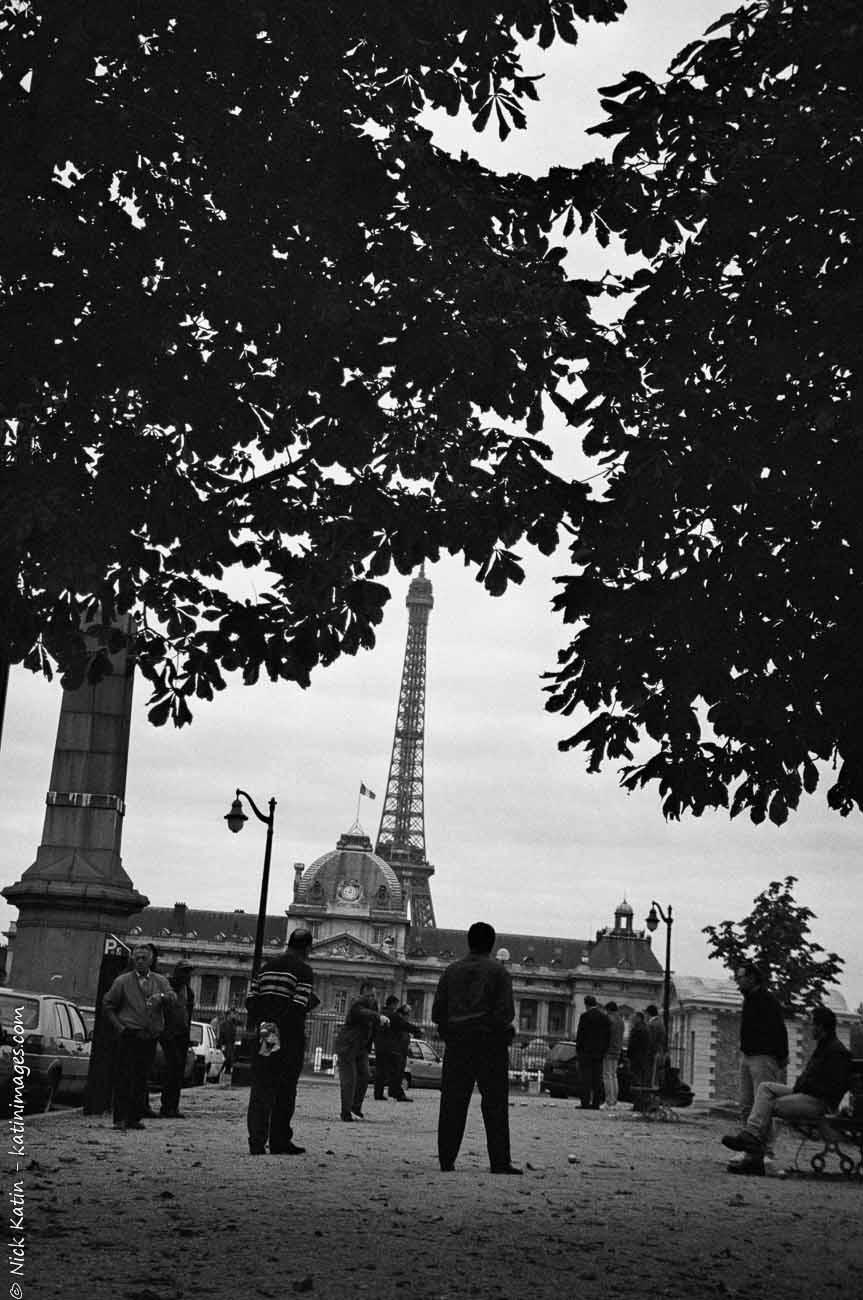 Men playing Pétanque near the Eiffel tower in Paris, France