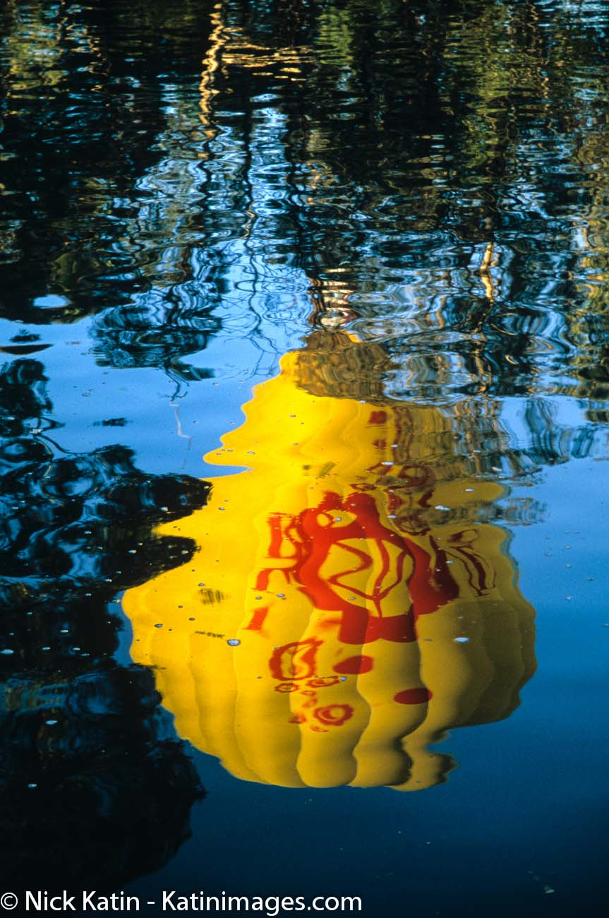 Yellow Balloon reflection on the Yarra river in Melbourne Australia