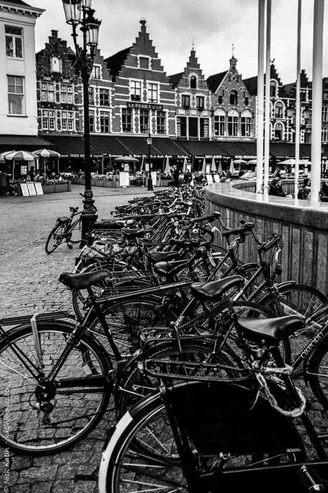 "Bicycles in clock tower plaza in Bruges, the 'Venice of northern Europe"",Belgium"