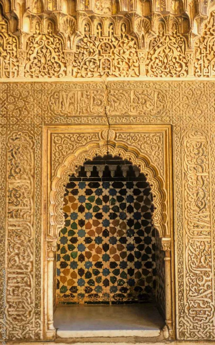 One of the beautifully crafted decorated door ways in the 13th century Alhambra Palace in Granada Spain