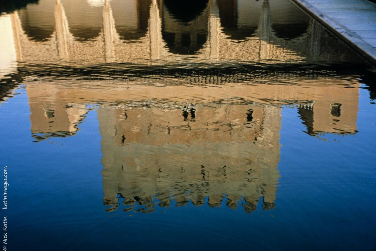 The reflection of one of the beautifully crafted decorated buildings in the 13th century Alhambra Palace in Granada Spain
