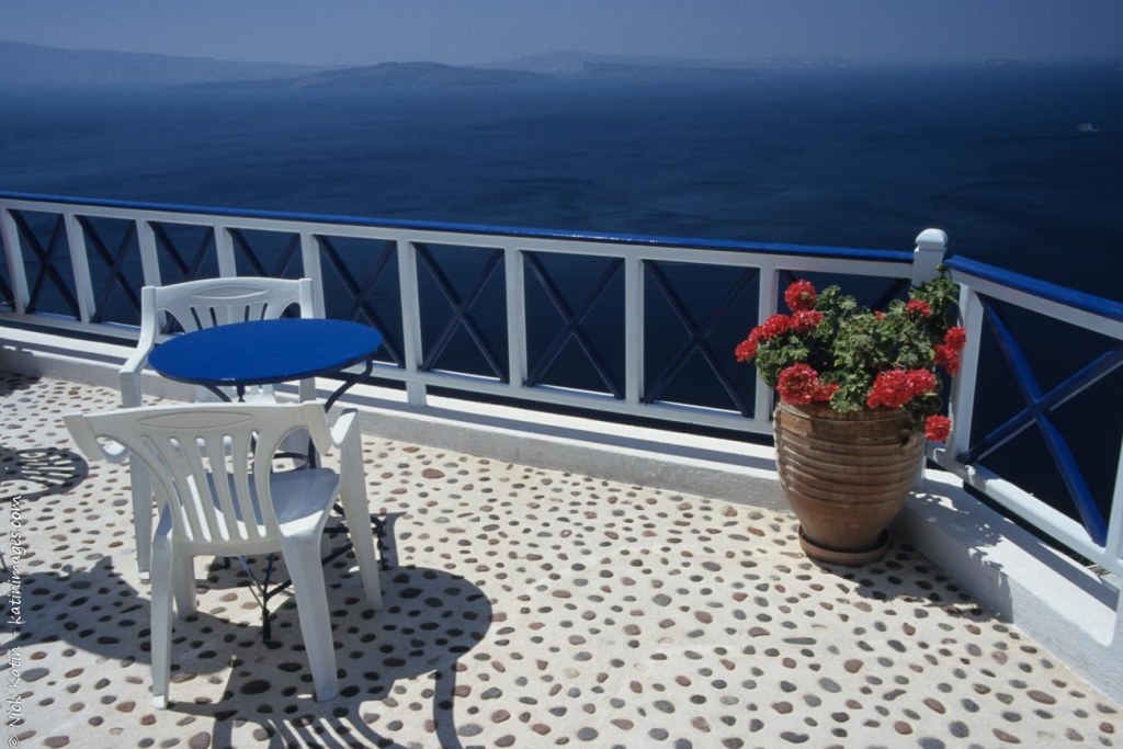 A blacony overlooking the Aegean Sea in Oia Santorini in the Greek Islands