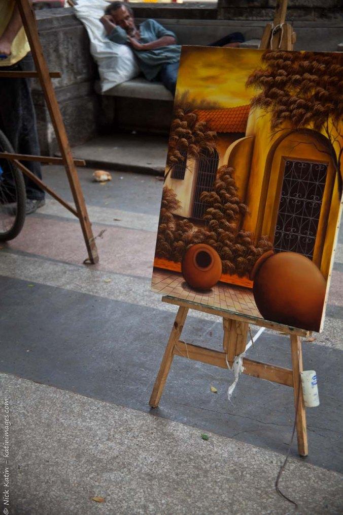 An art vendor asleep on the job in Havana's Prado
