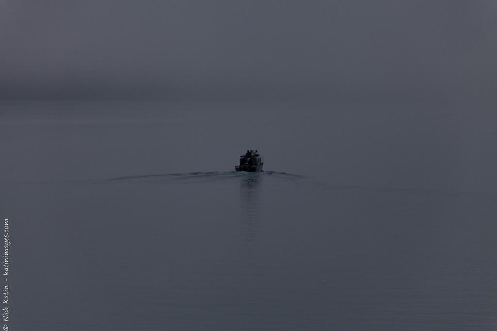 Local fishing boat heading through fog to sea from Whittier, Alaska, USA