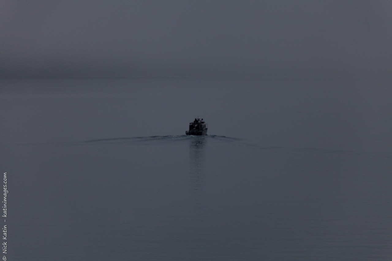 Local fishing boat heading through fog to sea from Whittier, Alaska, USA