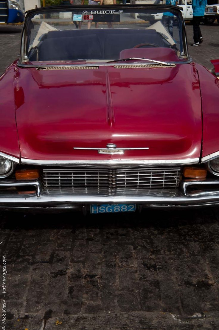 The front of a Red Buick, one of Havana's old classic cars