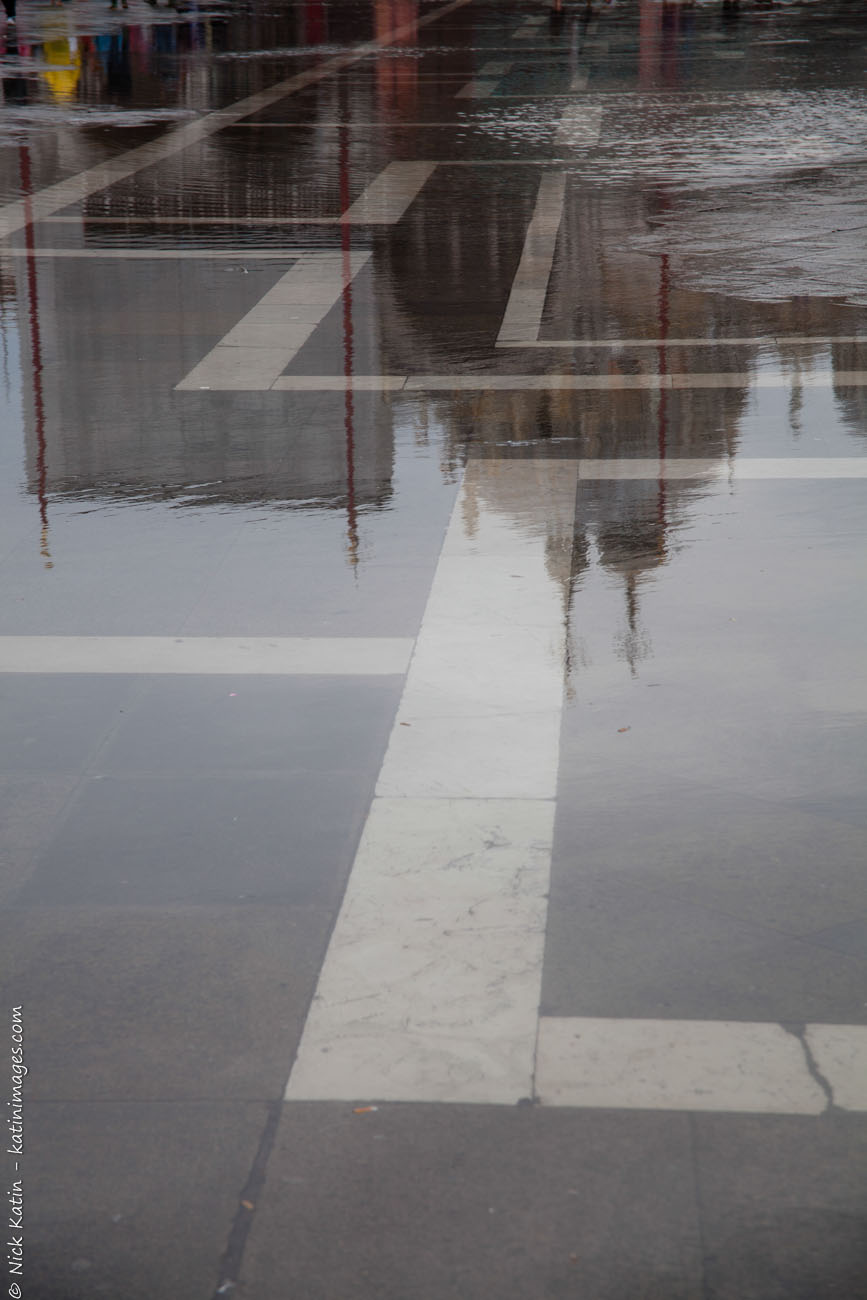 Reflections on a wet Piazza San Marco in Venice, Italy