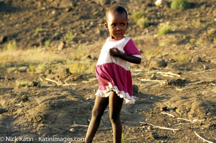 Young girl from Lesotho looking for her mother on a remote roadside.
