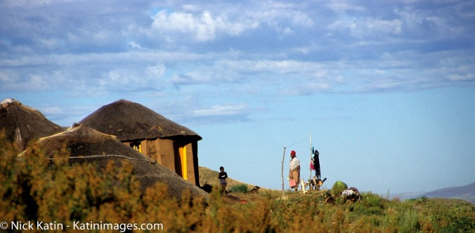 Mother and Boy outside a hut, their home in the mountains of Lesotho