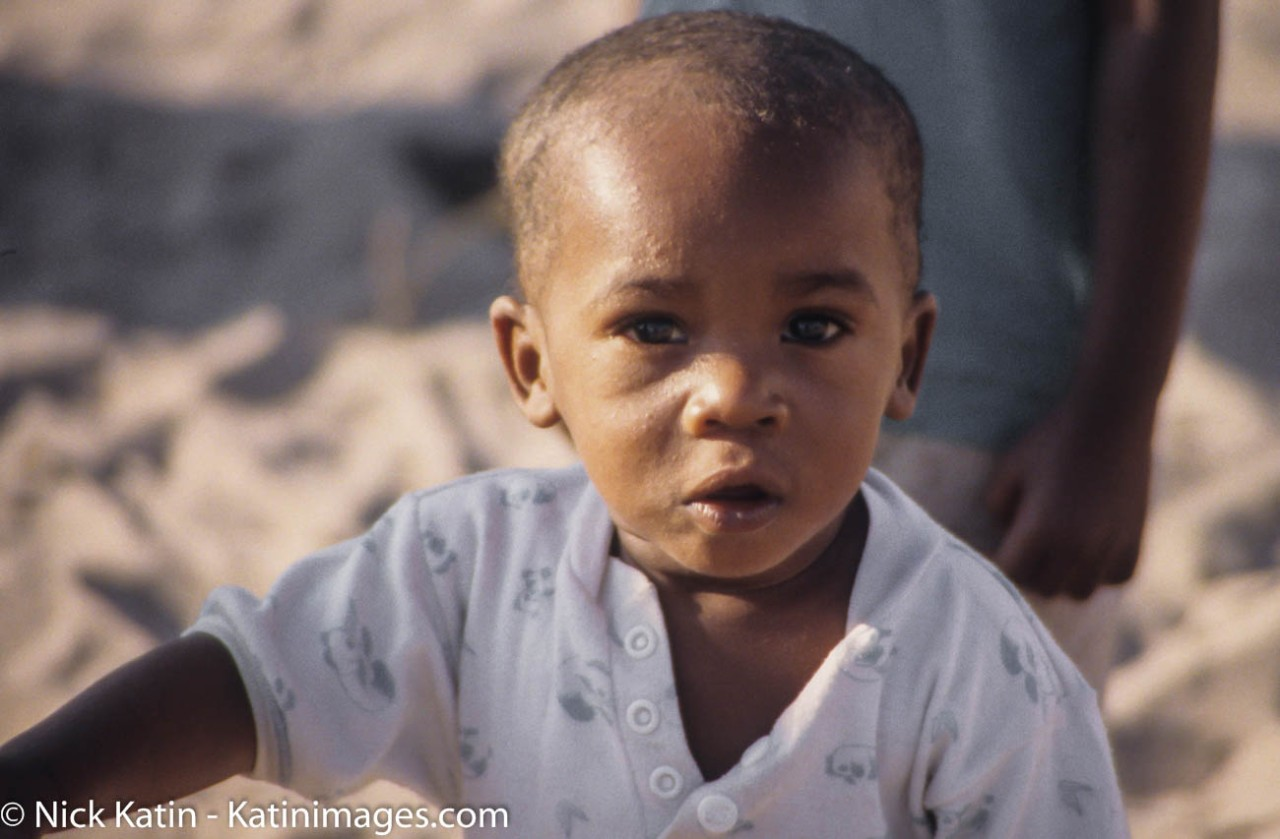Young Boy looks at the camera in a small village in Botswana