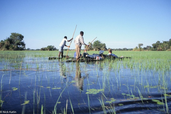 Polers on the makoros (canoe) in the Okavango delta, Botswana
