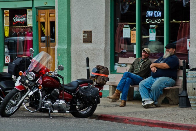 Two men and motorbikes in the historic copper mining town of Jerome, Arizona, USA