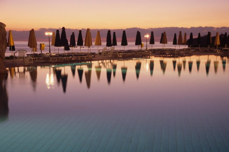 The main pool at dusk at the Capital Coast Resort in Cyprus