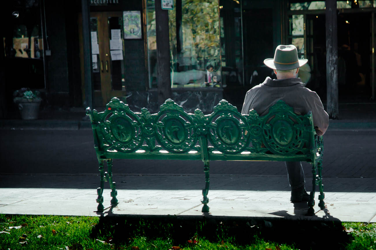 Cowboy on bench In Santa Fe's plaza, New Mexico, USA