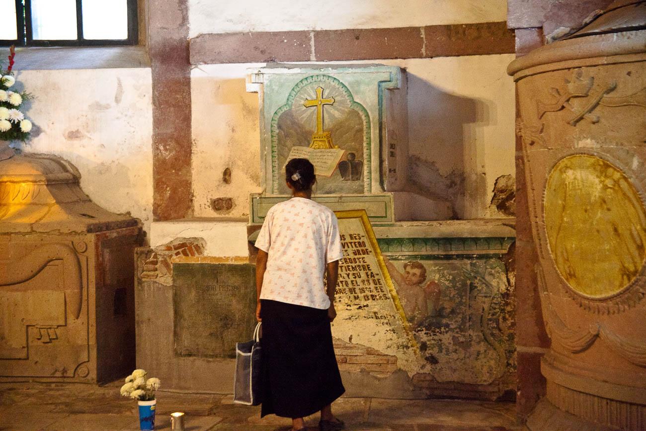 Women grieving in San Miguel de Allende's parroquia crypt
