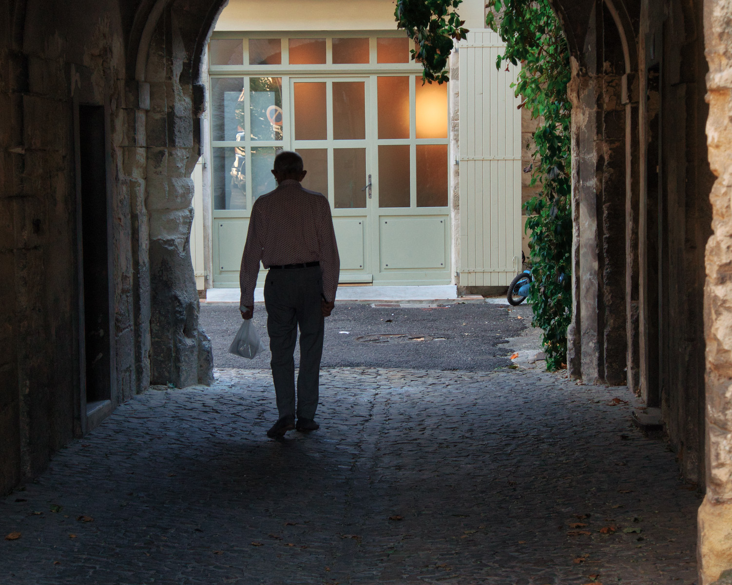 An elderly man walks home in Avignon France