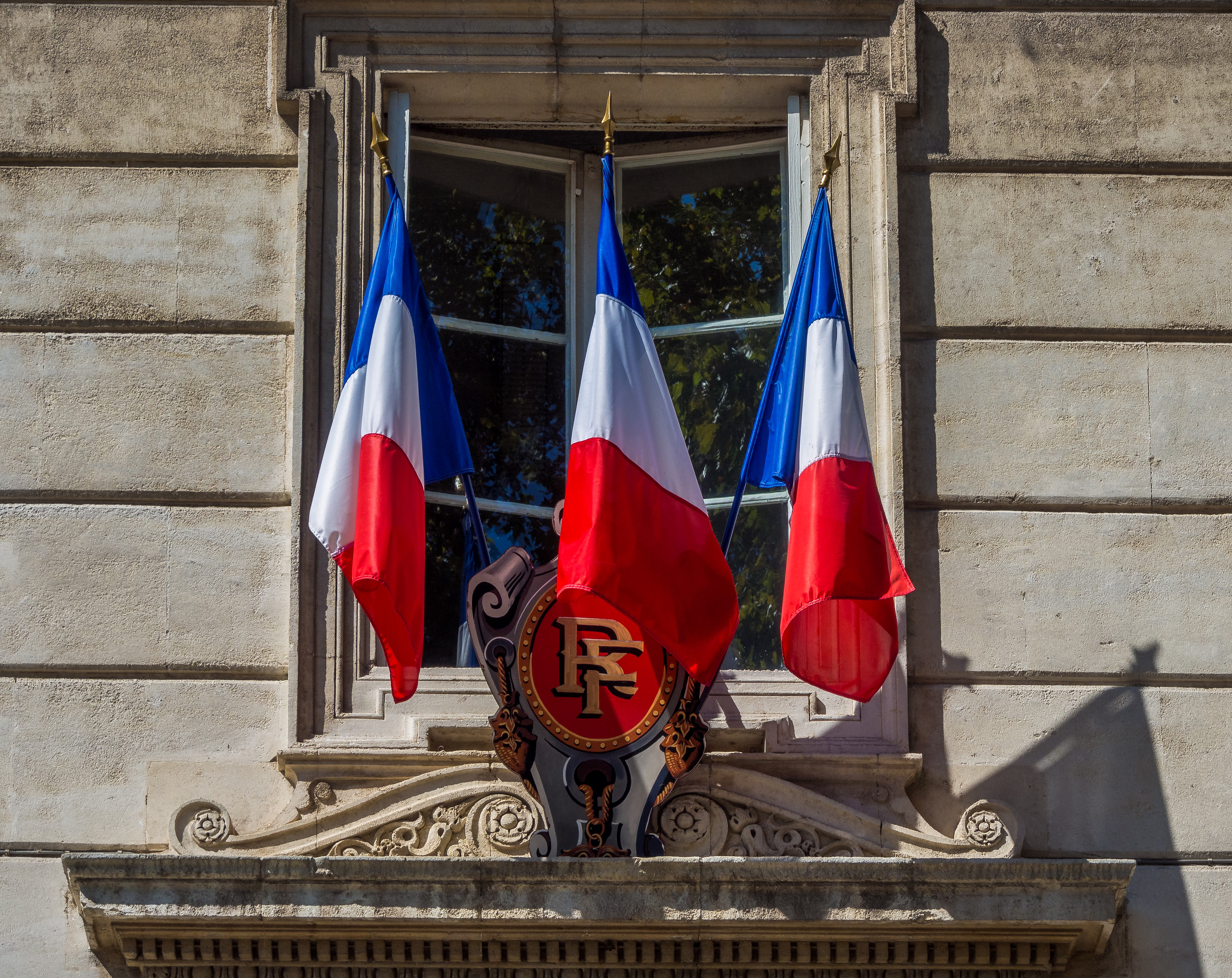 French flags outside the Avignon Town Hall.