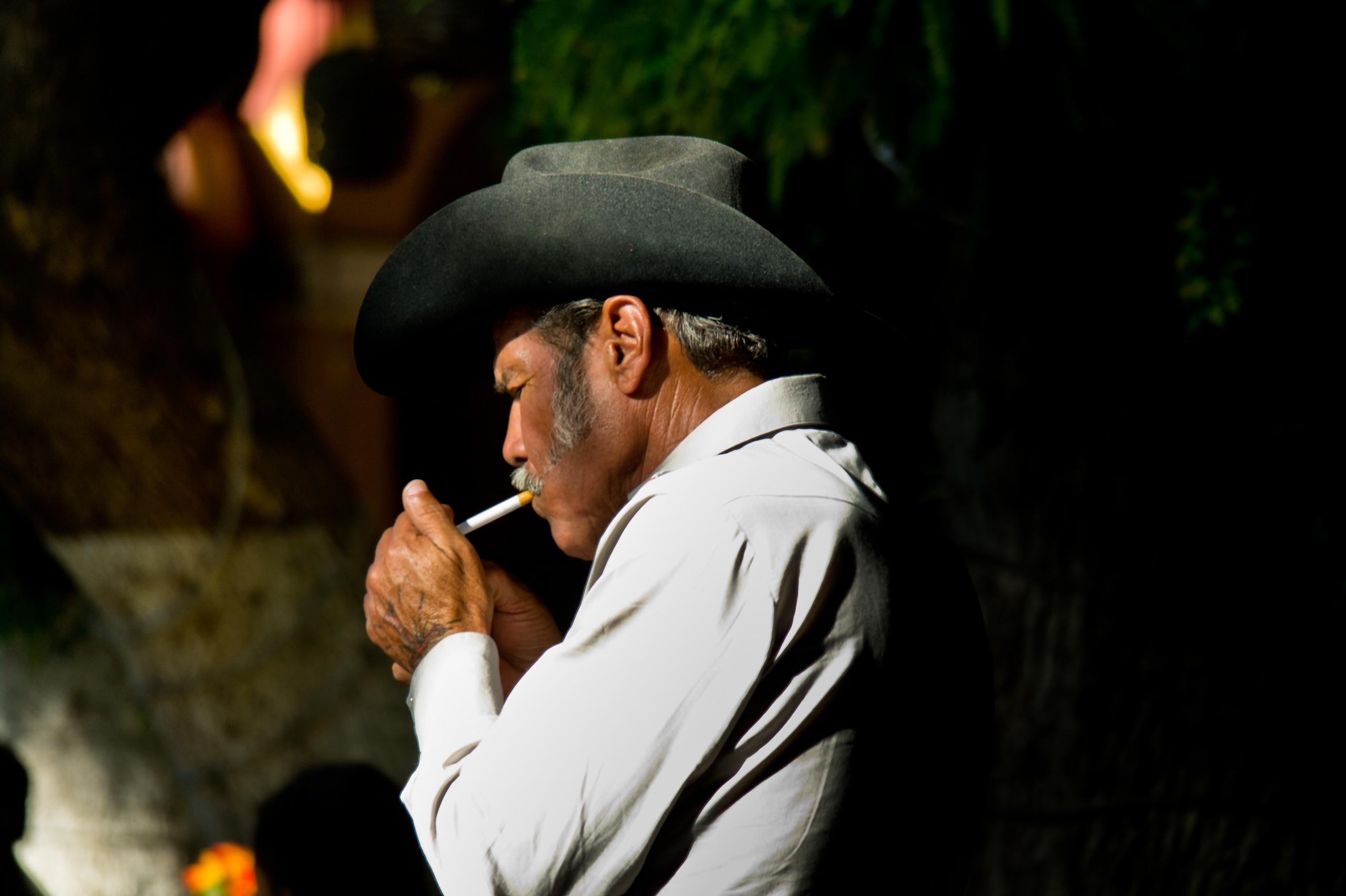 A Cowboy lights up at El Parian, Tlaquepaque, Guadalajara, Mexico.